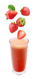 Strawberry falling into a glass of fresh juice Royalty Free Stock Images