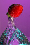 Strawberry falling in water Royalty Free Stock Image