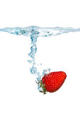 Strawberry falling into the water Royalty Free Stock Images