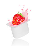Strawberry falling into yogurt splash in plastic packing Royalty Free Stock Photography