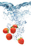 Strawberry falls deeply under water Royalty Free Stock Images