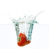 Strawberry falls deeply under water Stock Photos