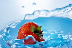 Strawberry falls deeply under water Royalty Free Stock Image
