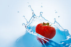 Strawberry falls deeply under water Stock Images