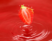 The strawberry falls in own juice Royalty Free Stock Photos