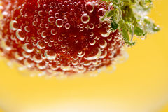 Strawberry Fizz Refreshment. Fresh strawberry in refreshing bubbly Royalty Free Stock Photography