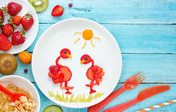 Strawberry flamingo for healthy breakfast or dessert. Fun food art for kids with fresh fruit and berry - strawberry flamingo for healthy breakfast or dessert royalty free stock photo