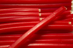Strawberry flavored candy sticks Stock Image