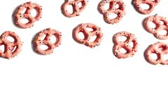 Strawberry flavoured yogurt covered pretzels on white background. With copy space stock photography