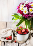 Strawberry and flowers Stock Images