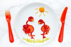 Strawberry food art for kids, edible flamingo on plate. From ripe fresh strawberries stock photography