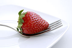 Strawberry on a fork Royalty Free Stock Photos