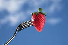 Strawberry on fork Royalty Free Stock Image