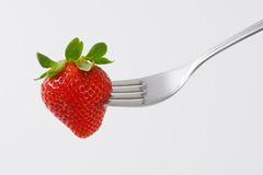 Strawberry on fork Royalty Free Stock Photos
