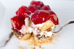 Strawberry on Fork with Pie Behind Stock Photos