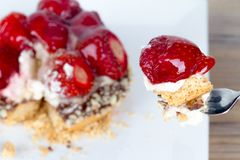 Strawberry on Fork with Pie Behind Royalty Free Stock Images