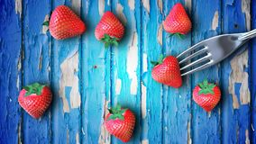 Strawberry on fork stock footage