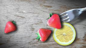 Strawberry on fork with wooden stock footage
