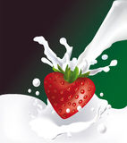 Strawberry in the form of the heart and milk splas Royalty Free Stock Images