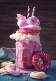 Strawberry freakshake. With donuts and candy floss stock images