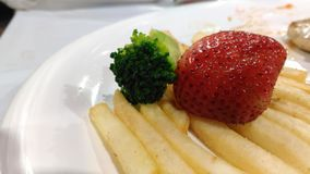 Strawberry on french fried Stock Photo