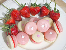 Strawberry french macarons with heart Stock Photo