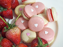 Strawberry french macarons with heart Royalty Free Stock Photos
