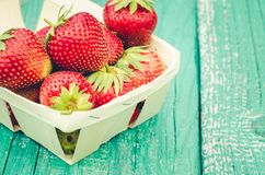 Strawberry. fresh berries of strawberry on wooden table closeup/Selective focus. Strawberry in small basket on natural wooden. Strawberry. fresh berries of stock photos