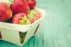 Strawberry. Fresh berries of strawberry on wooden green table/Selective focus. Strawberry in small basket on natural wooden stock photos