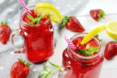 Strawberry fresh drink cocktail with lemon. Slice Stock Photography
