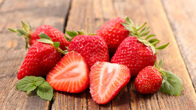 Strawberry. Fresh strawberry with eaf on wood stock photo
