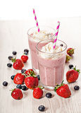 Strawberry fresh milkshake summer drink. Strawberry fresh milkshake cold summer berry drink Royalty Free Stock Images