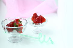 Strawberry. Fresh strawberry pieces in a rustic glass Stock Photography