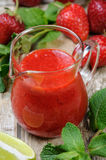 Strawberry fresh sauce. With mint and lime. Vertical shot. Close-up Royalty Free Stock Image