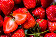 Strawberry. Fresh sliced strawberry and red Royalty Free Stock Image