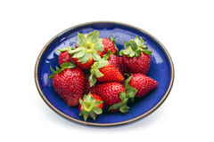 Strawberry. Fresh strawberries in blue bowl isolated on white background royalty free stock photography