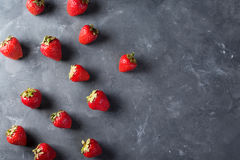 Strawberry. Fresh strawberry on dark background . Red strawberry. Loosely laid strawberries in different positions. Copyspace Stock Photo
