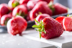 Strawberry. Fresh strawberry. Red strewberry. Strawberry Juice. Loosely laid strawberries in different positions.  Royalty Free Stock Images
