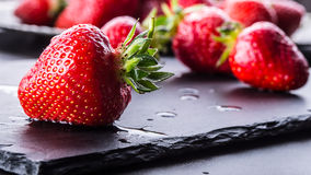 Strawberry. Fresh strawberry. Red strewberry. Strawberry Juice. Loosely laid strawberries in different positions.  Stock Image