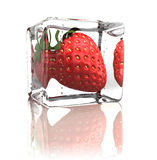 Strawberry frozen in ice cube Royalty Free Stock Photography
