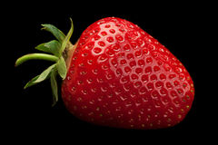 Strawberry fruit on black Stock Images