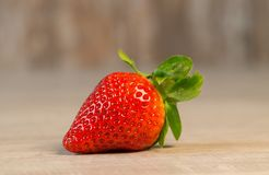 Strawberry Fruit on Brown Wooden Surface stock photography