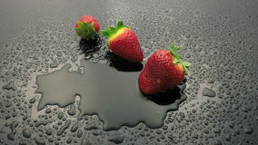 Strawberry fruit falling on wet stock footage