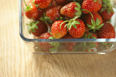 Strawberry fruit in a glass container. Royalty Free Stock Photography
