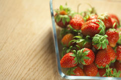 Strawberry fruit in a glass container. Royalty Free Stock Photos