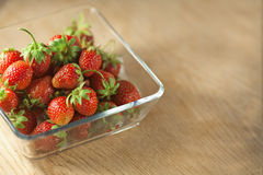 Strawberry fruit in a glass container. Stock Photo