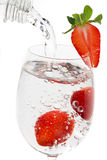 Strawberry fruit in a glass of water Stock Images
