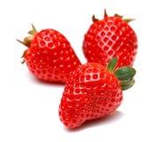 Strawberry fruit isolated on white background. Strawberries three ripe berries isolated on white background Royalty Free Stock Image