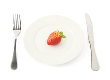 Strawberry fruit in a plate isolated Royalty Free Stock Photo