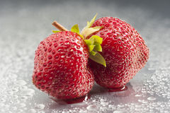 Strawberry, fruit, red, macro, freshness, wet, stu. Two ripe strawberries in mouth shape. Horizontal shoot in studio on silver background. Dew and droplets Stock Photo